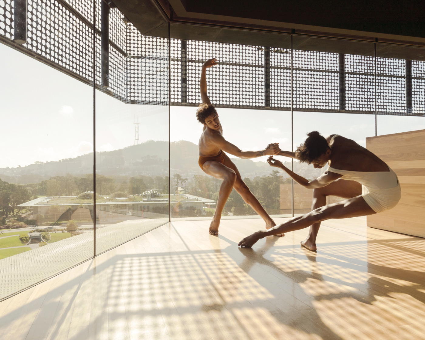 Photo of two dancers swinging inside of an enclosed deck