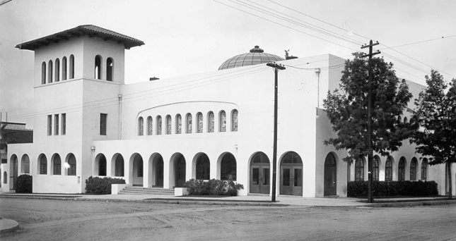 Black and white photograph of a squat modern building