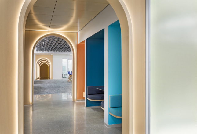 Interior of the Autodesk office showing a timber-clad, illuminated hallway