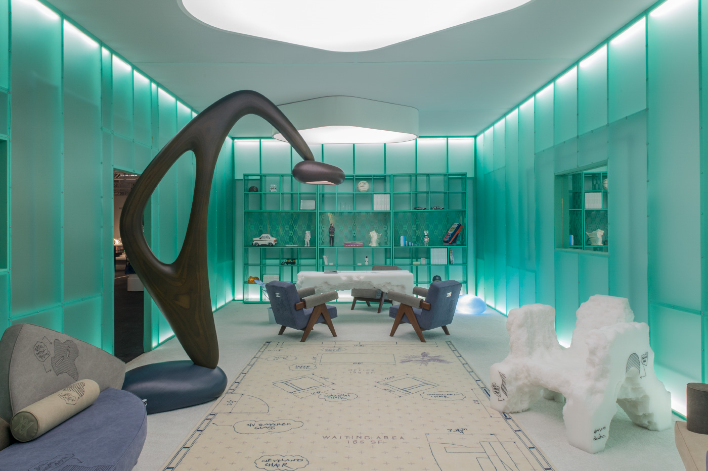 Interior of a green pavilion with glowing walls full of collectible design objects
