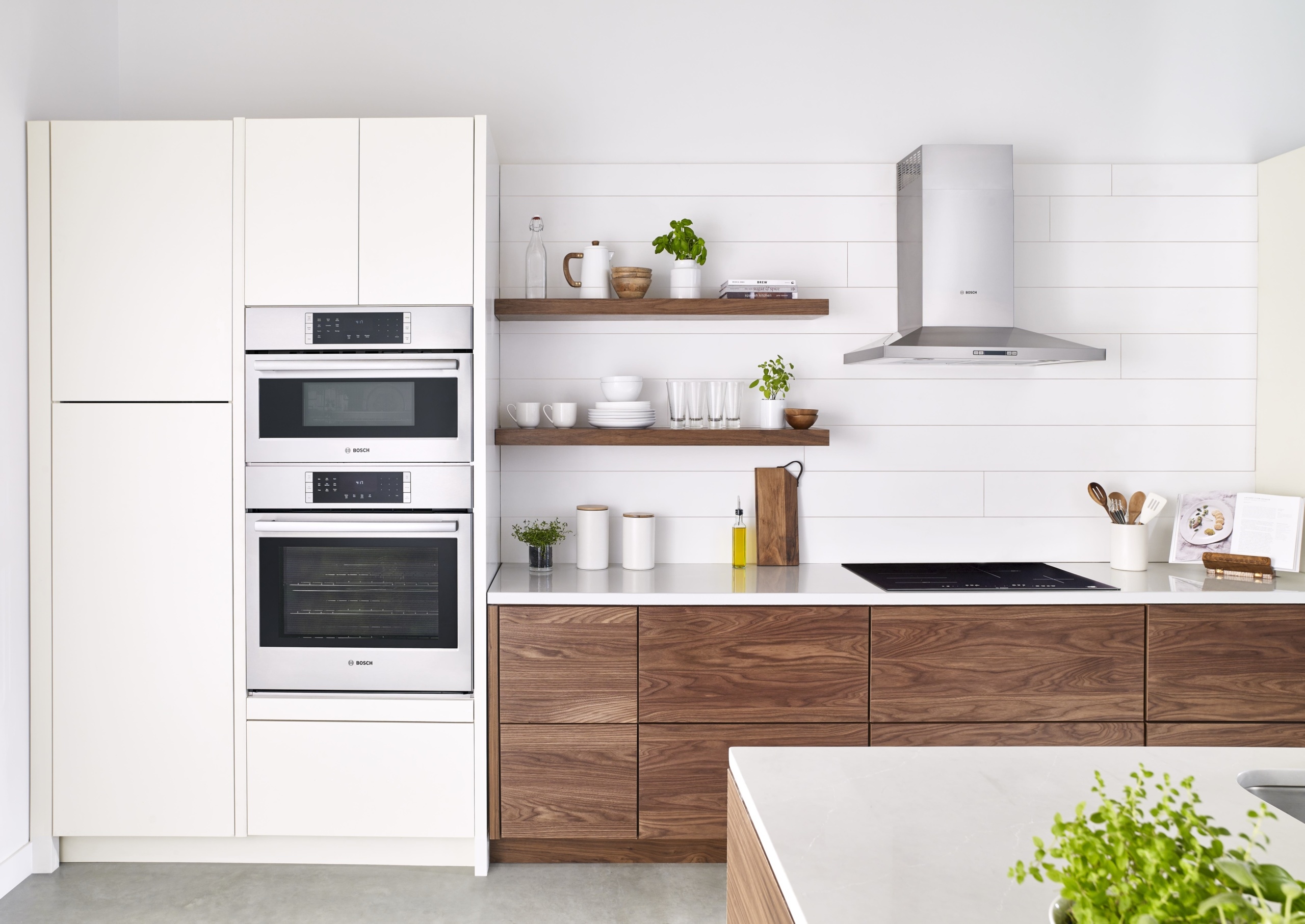 Interior of a kitchen with new appliances and wood shelve