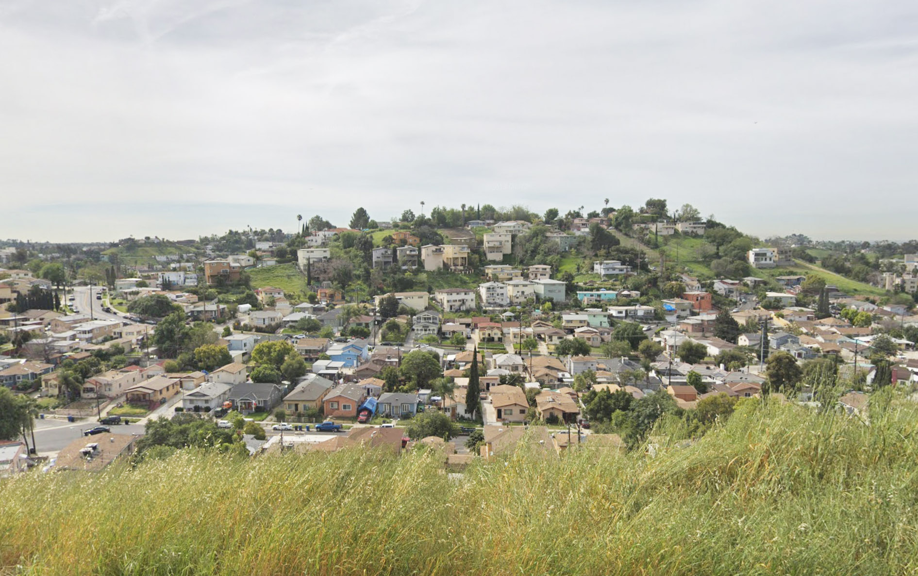 hills with several homes and streets