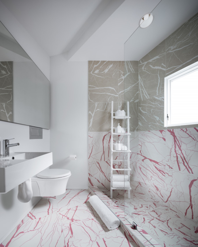 Interior of a bathroom with fake marble, designed by Jennifer Bonner
