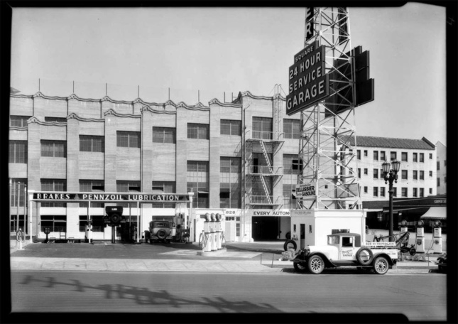 Black and white historic photo of a stepped parking garage