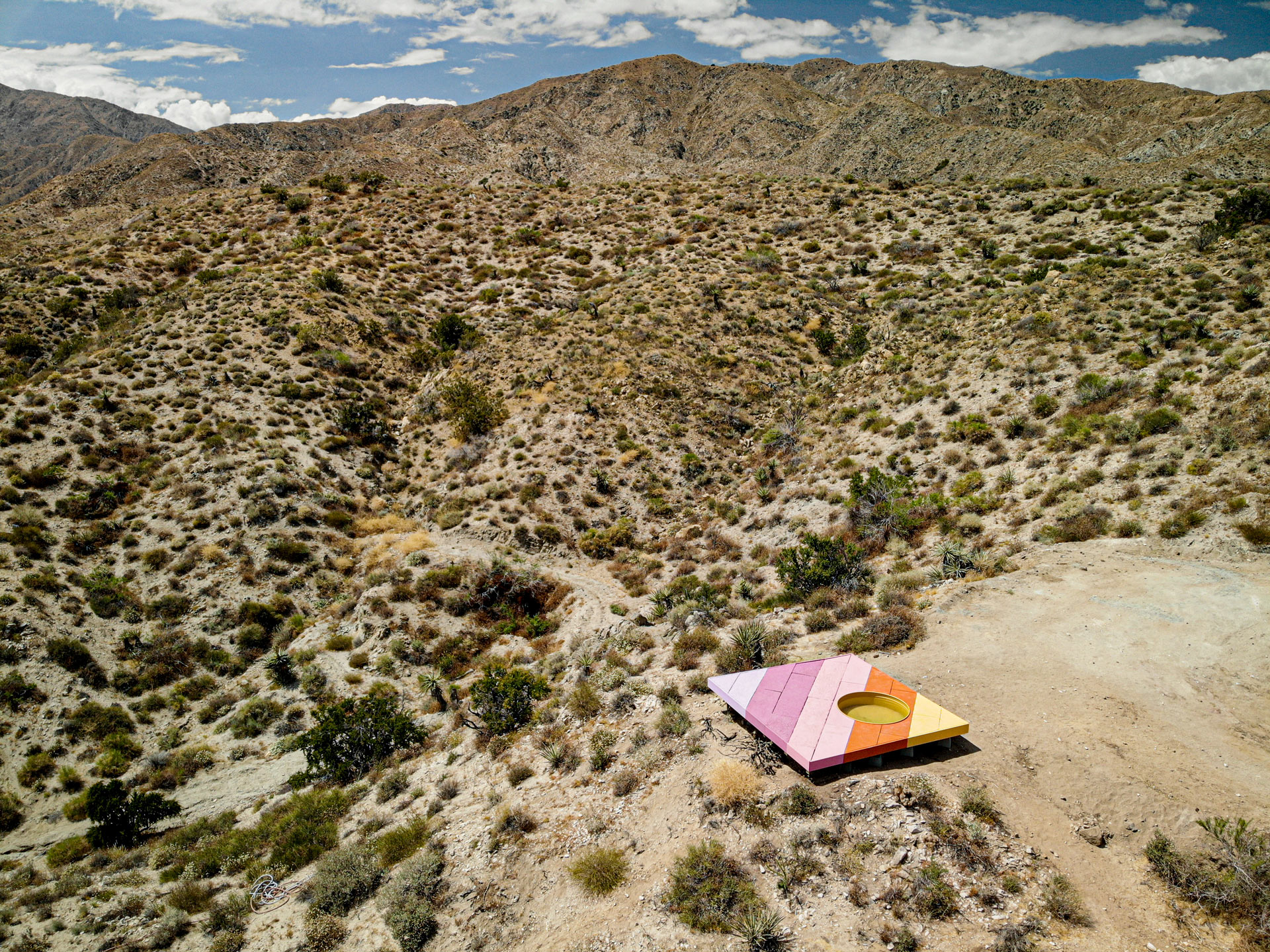 A vast valley with a desert, and a colorful board installation