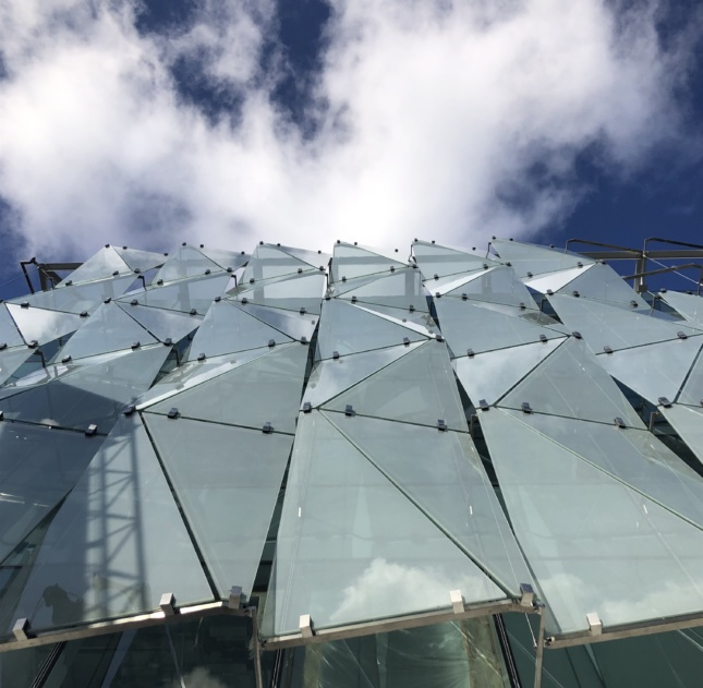 Construction image of the double skin glass facade looking up