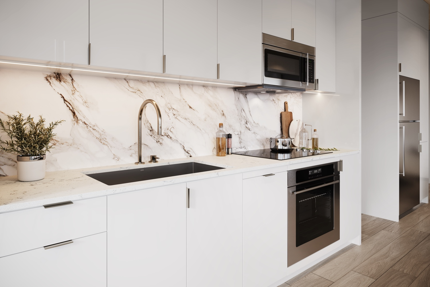 Interior of a kitchen with marble blacksplash and white cabinets