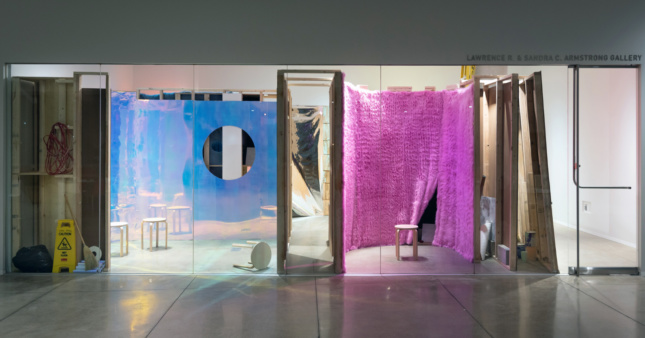 View of a gallery show with various cuts and wall segments behind it