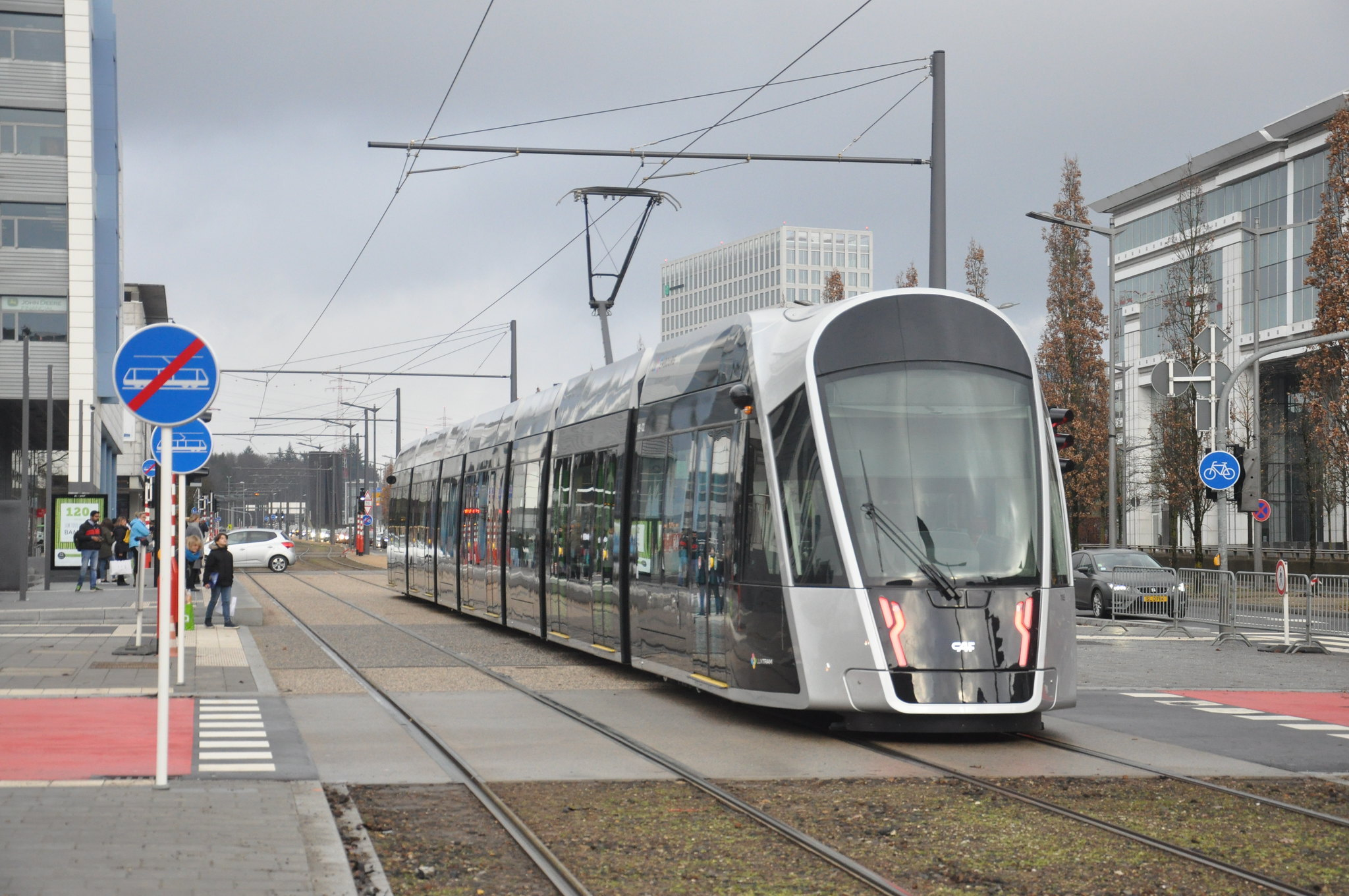 a modern tram moves through a city