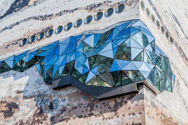A glass walkway protruding from a stone building in South Korea
