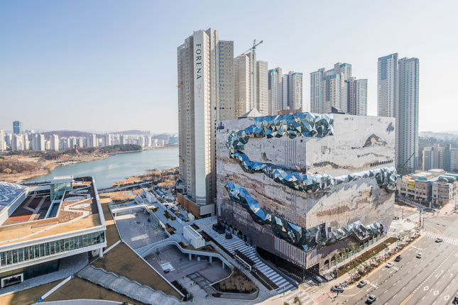 A bizarre-looking building set against a cluster of high-rises in South Korea.