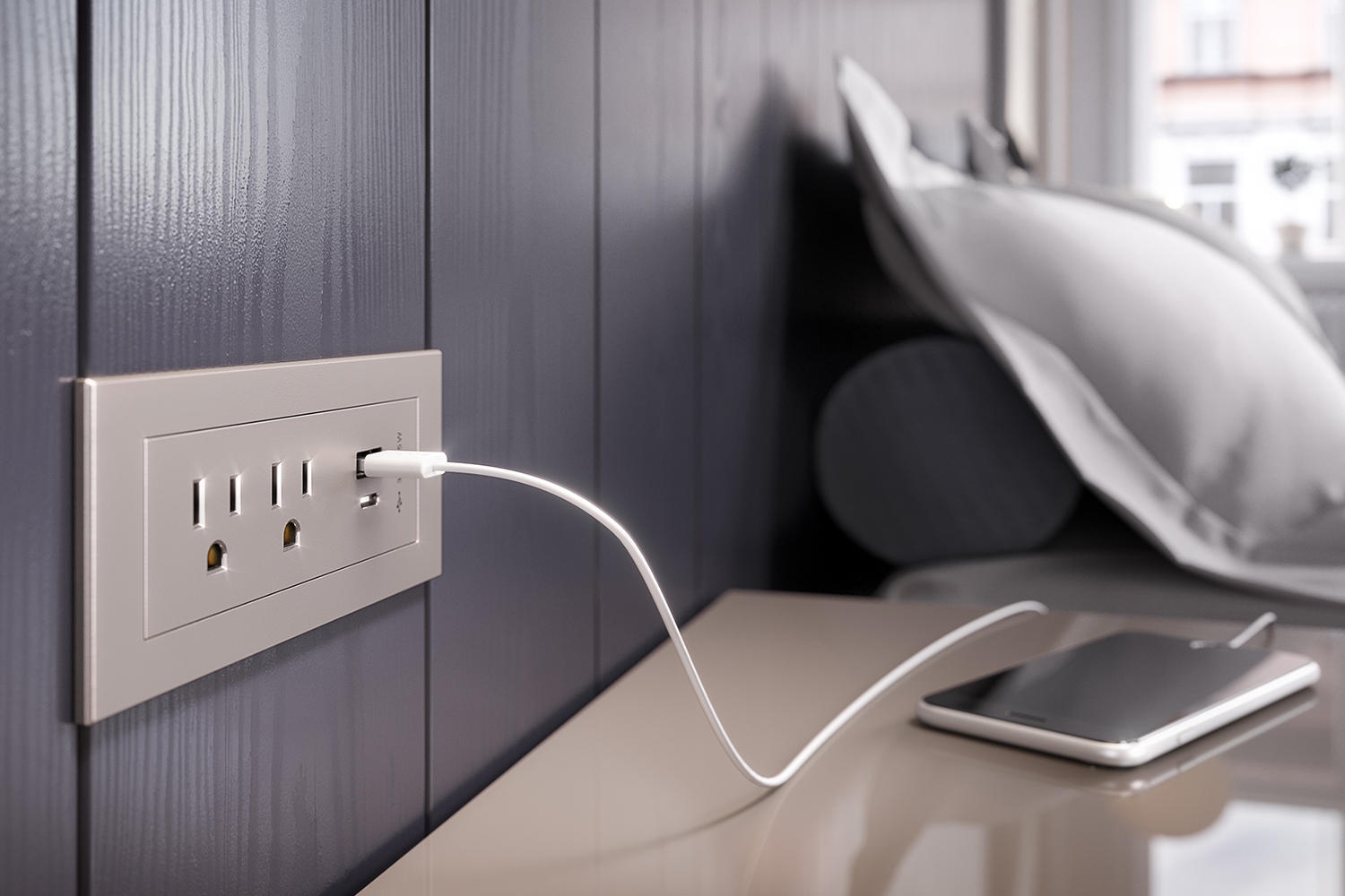 Photo of an iPhone charger going into a wall