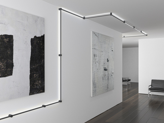 modular lighting on a track moving on a ceiling