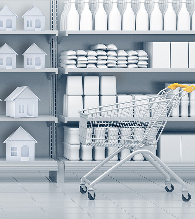 shopping cart in an all grey grocery aisle, products on shelves are houses