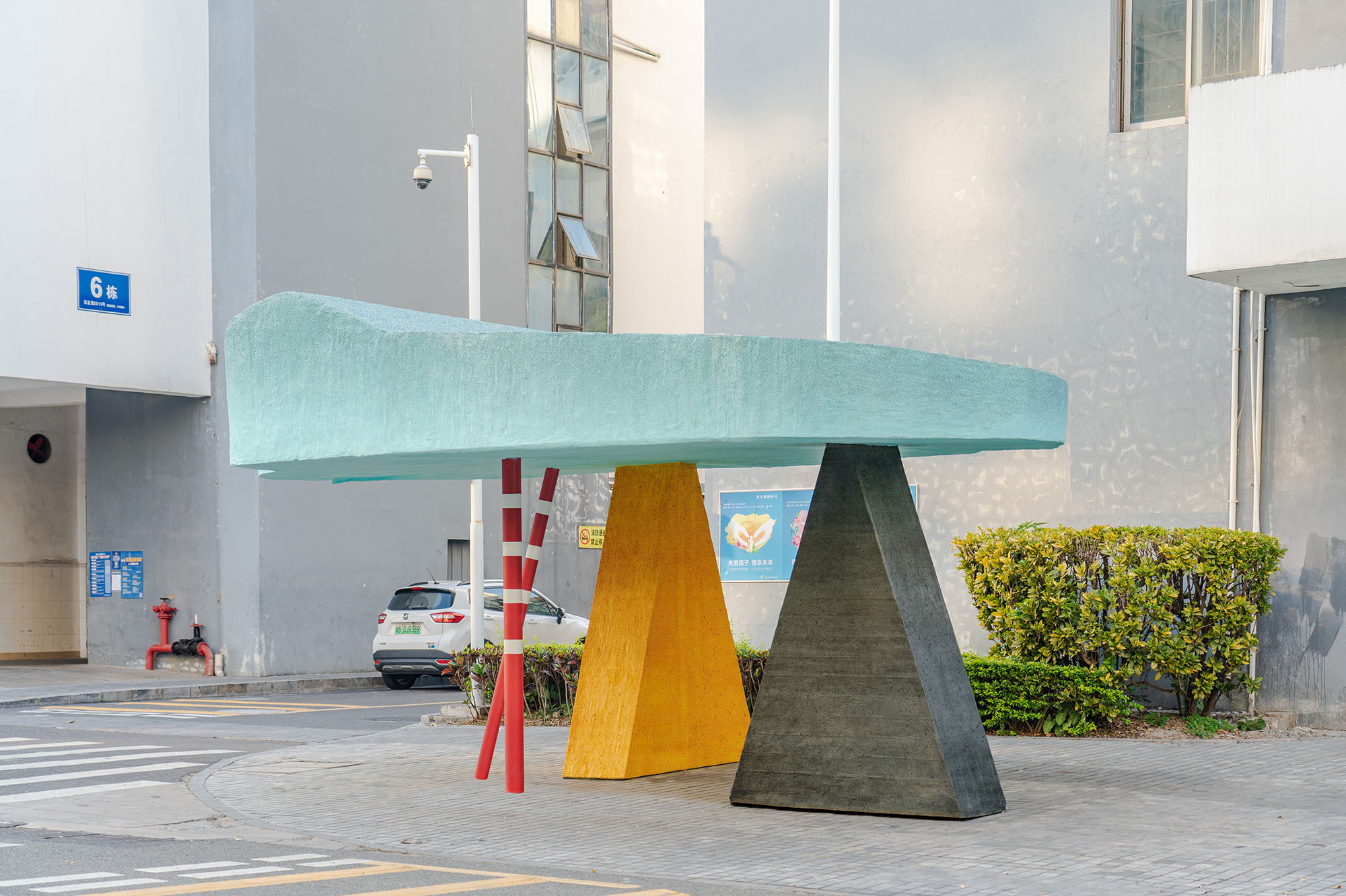 Object on a street corner, a triangular shelter designed by Sam Jacob Studio