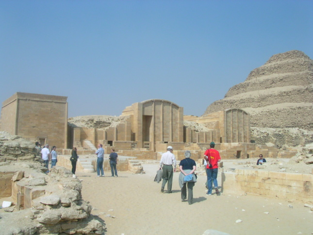 A group of tourists wandering around the Pyramid of Djoser