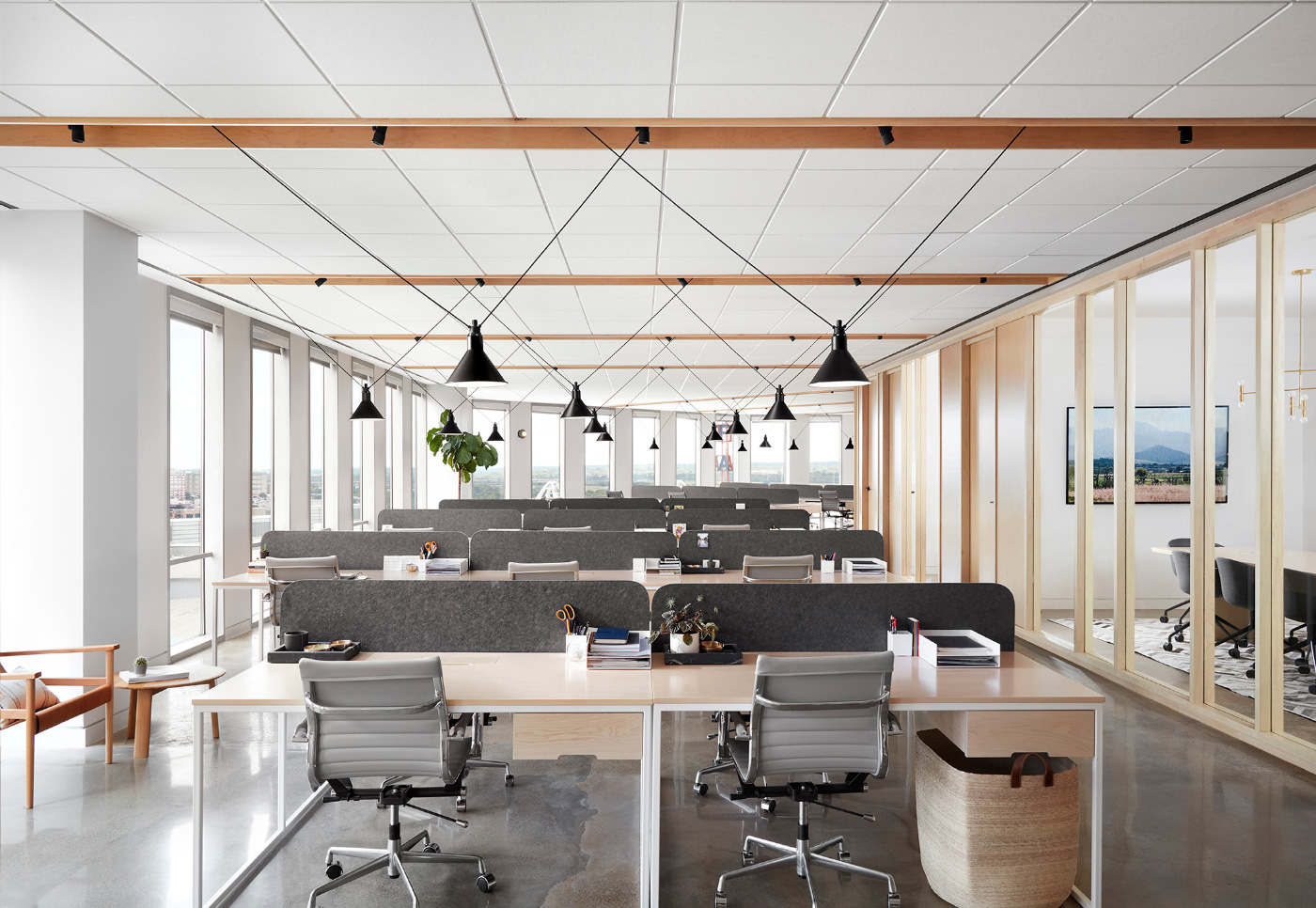 The Thoughtbarn-designed office has pendant lights and exposed beams
