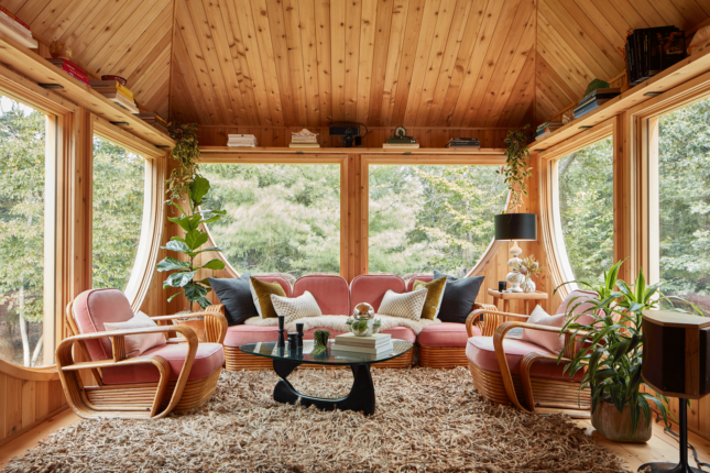Room with furniture, carpeting and wooden ceiling inside an Andrew Geller-designed home