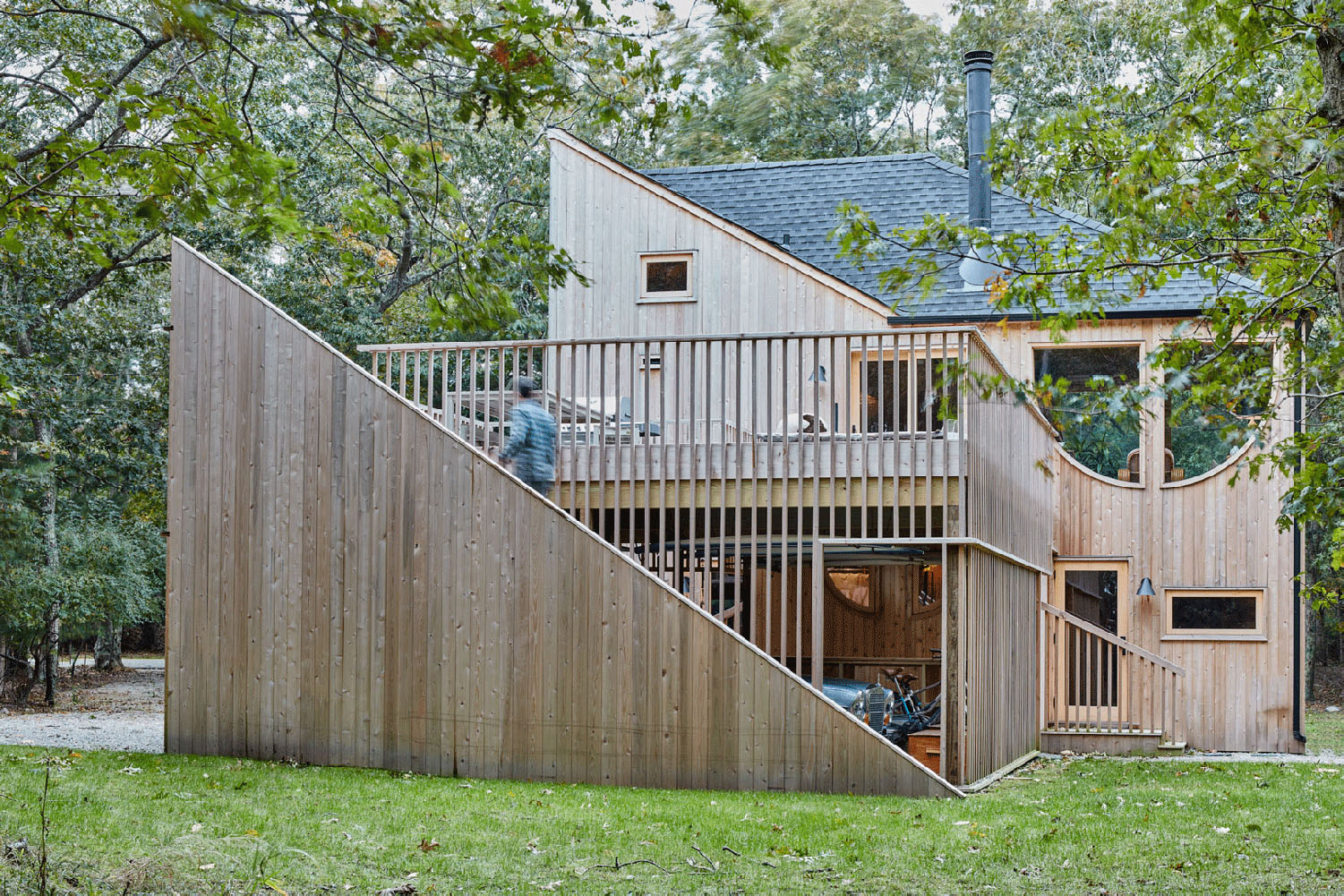 Wooden building with surrounding landscape designed by Andrew Geller