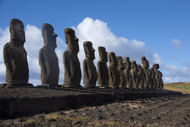 easter island statues lined up on a hill