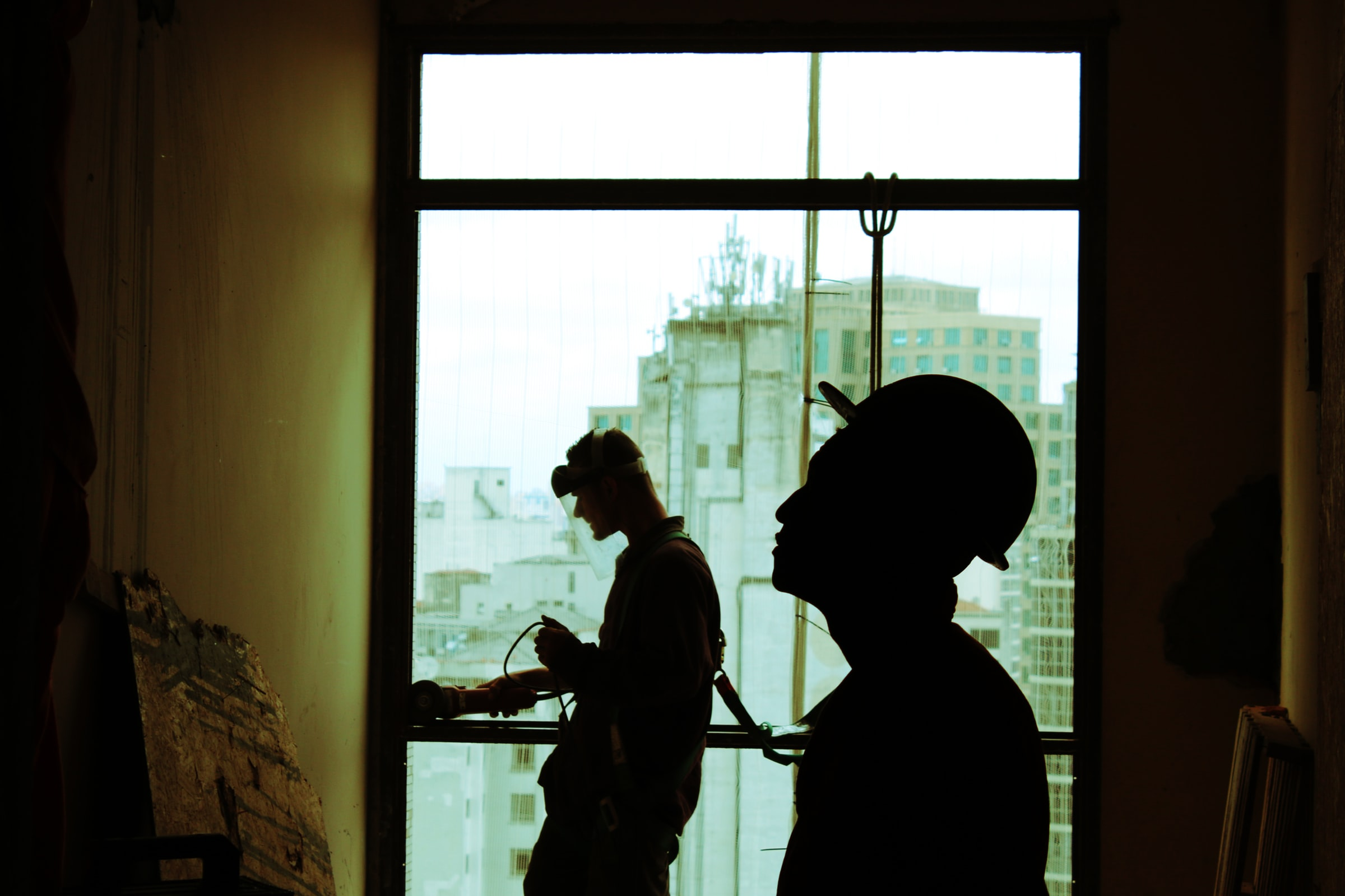 Photo of construction workers in silhouette