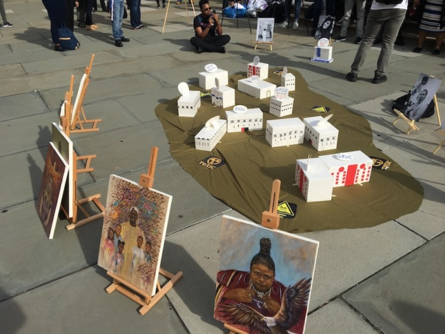 Photo of a Rikers demonstration on a sidewalk outside of a courthouse