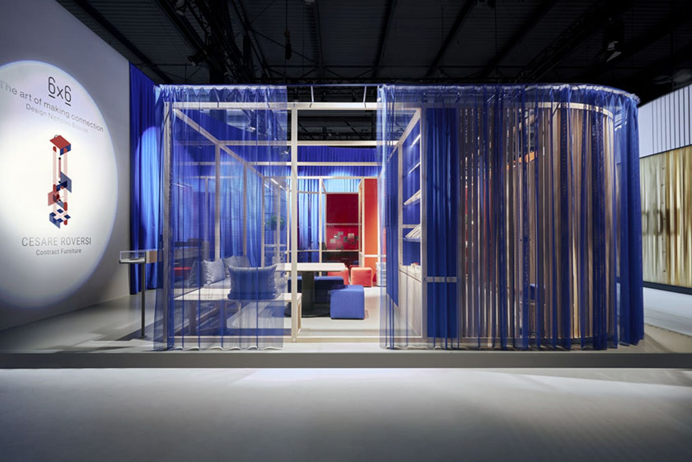 living room gallery installation surrounded by translucent blue fabric