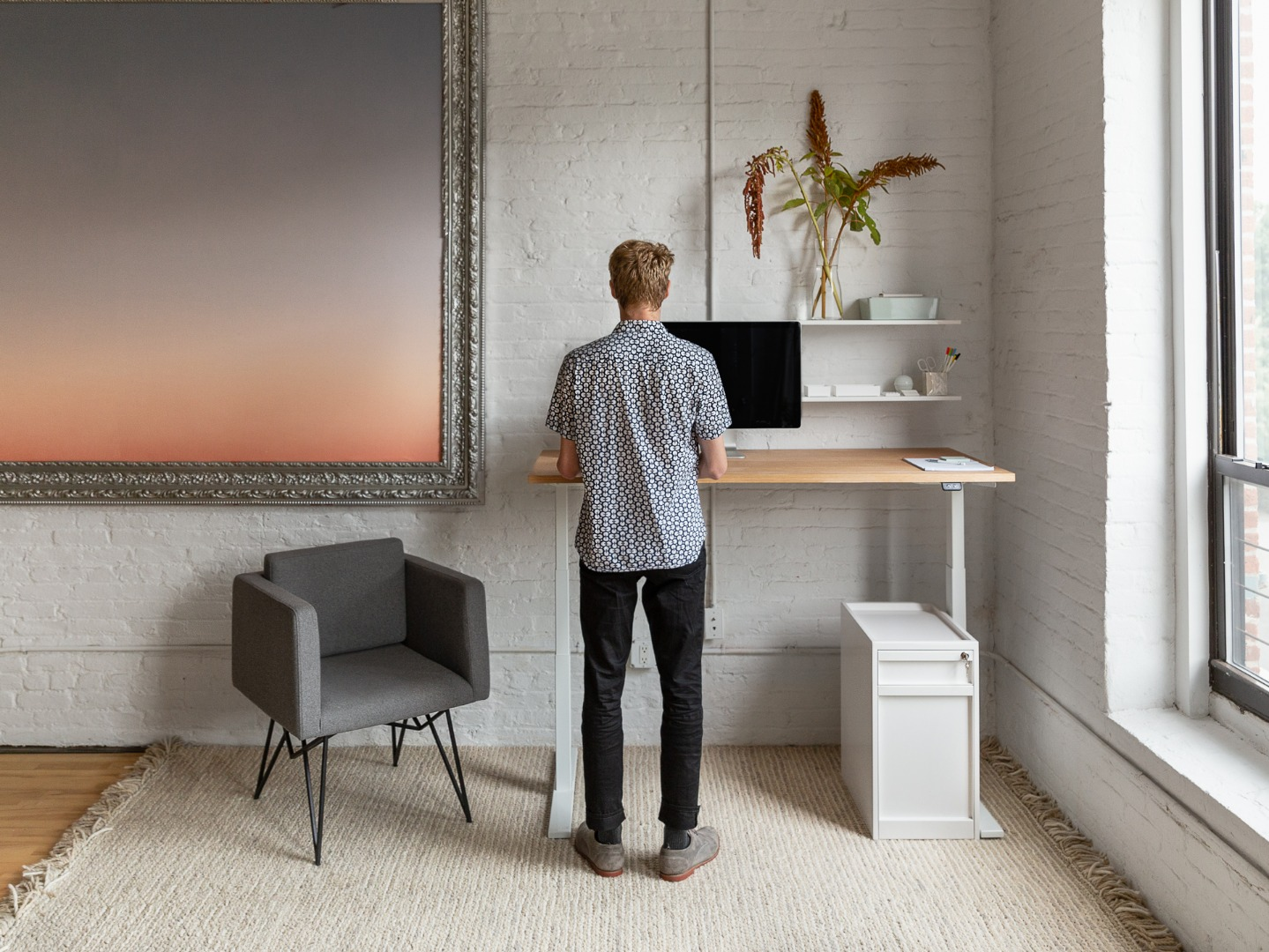 A man working from home at a standing desk