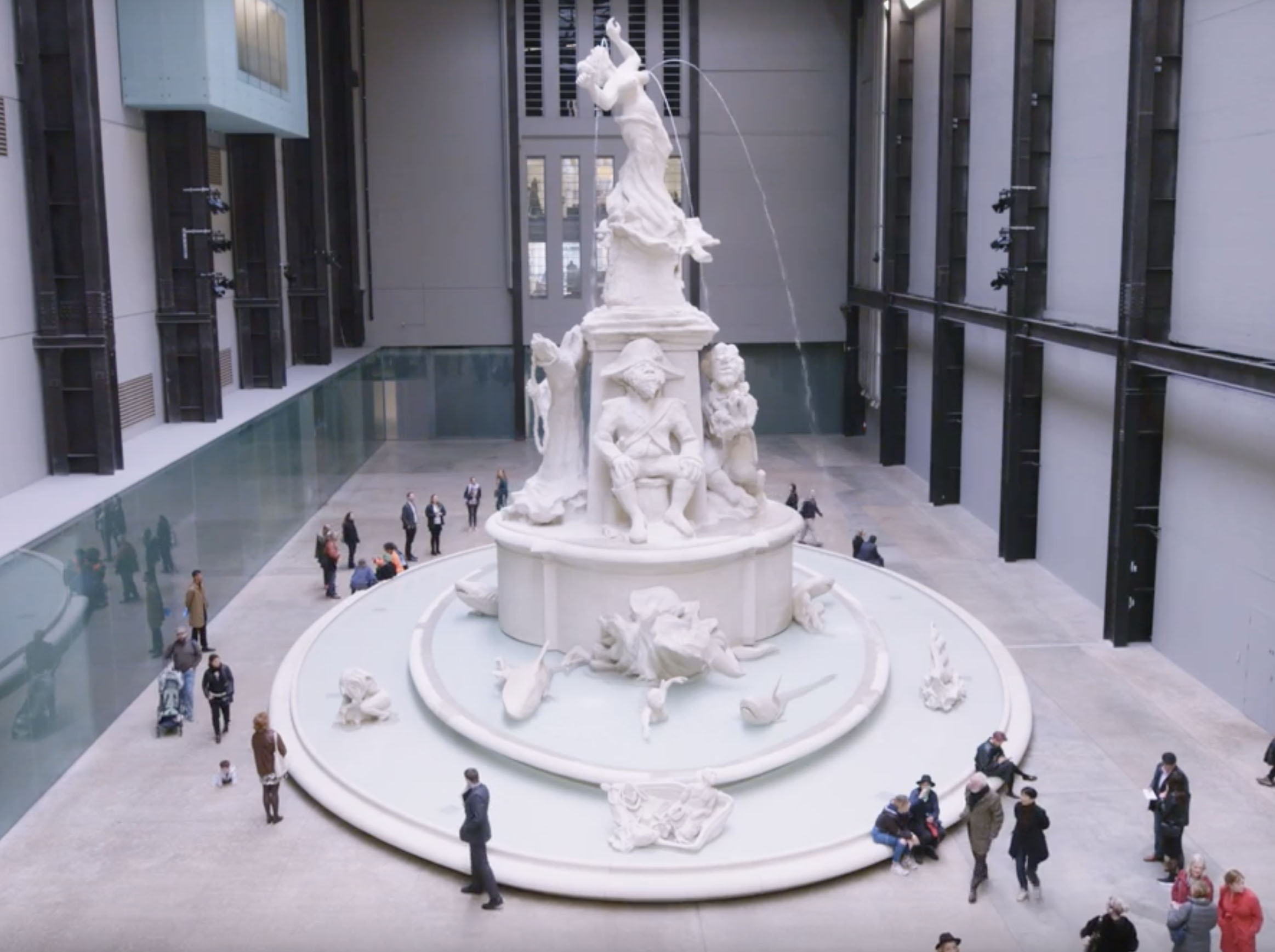 Large, monochrome sculpture in exhibition space designed by Kara Walker