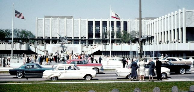 cars and people in front of museum buildings at LACMA