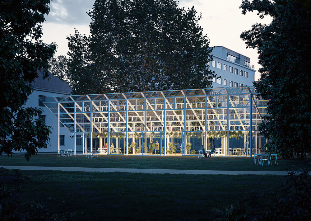 a renovated historic greenhouse pictured at dusk, which will rise on the site of the one where Gregor Mendel conducted his experiments