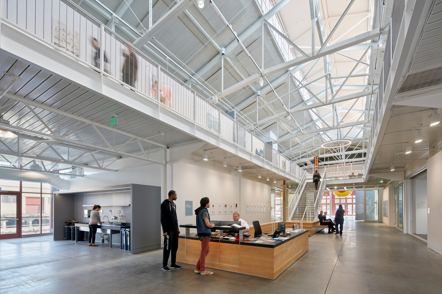 Interior of a converted warehouse with exposed trusses, now a building for the San Francisco Art Institute