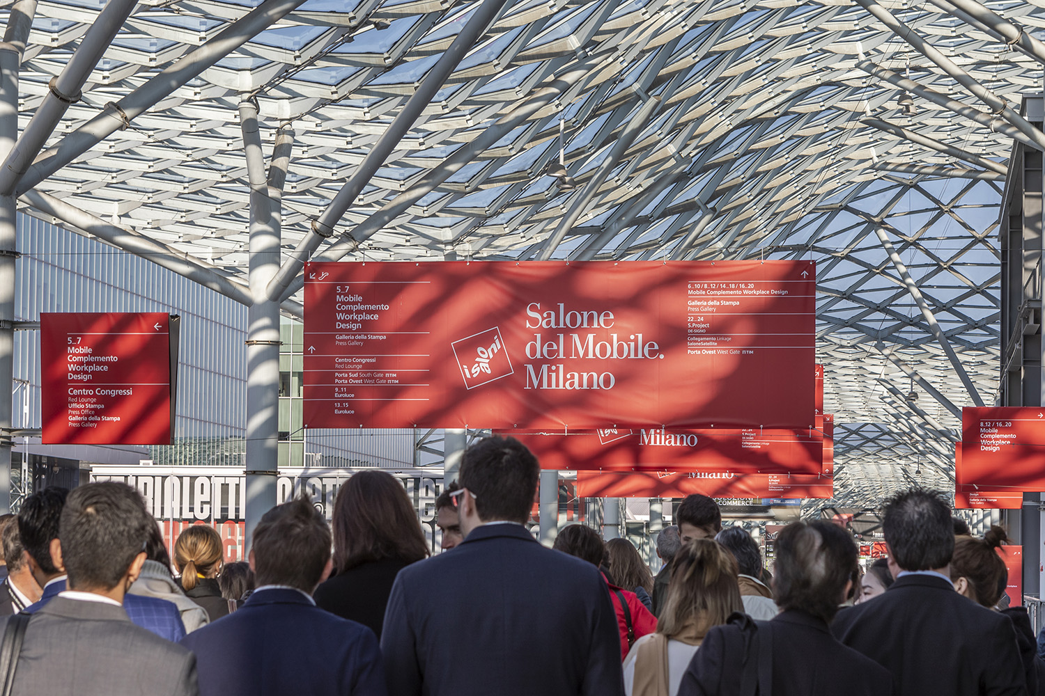 Interior photo of a festival with a red Salone del Mobile banner
