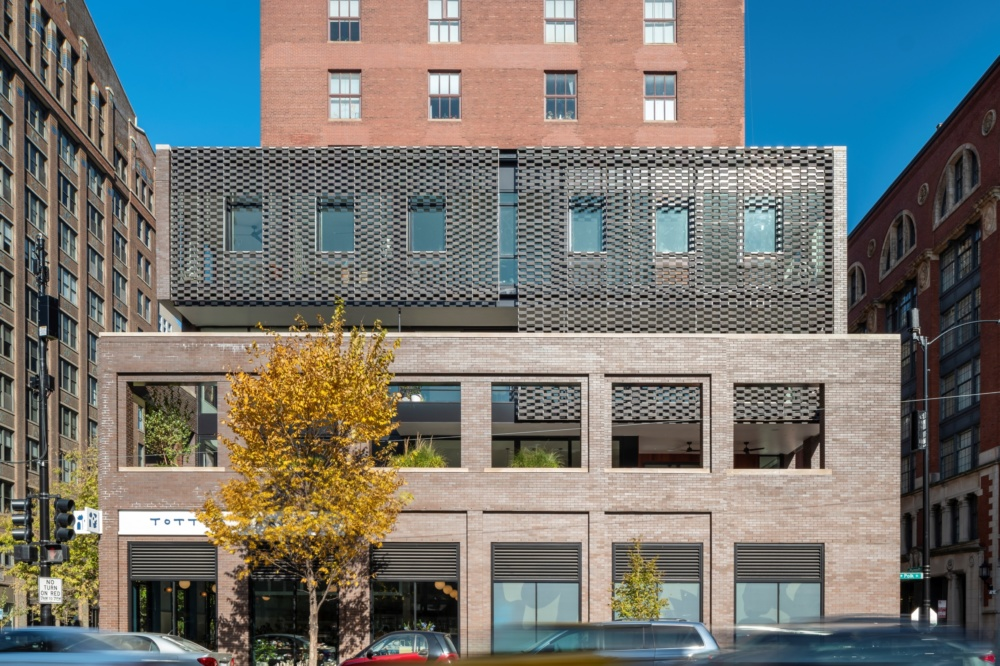 Exterior image of the Dearborn Residence and its brick and terra-cotta facade