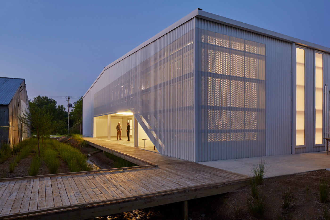 A warehouse clad in perforated aluminum, for the University of Arkansas