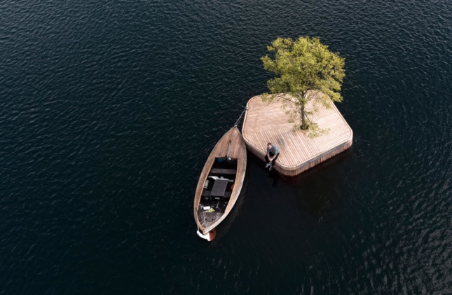boat next to small wooden island
