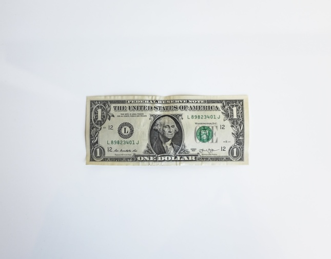 Photo of a one dollar bill. Such money can be acquired as part of coronavirus relief efforts