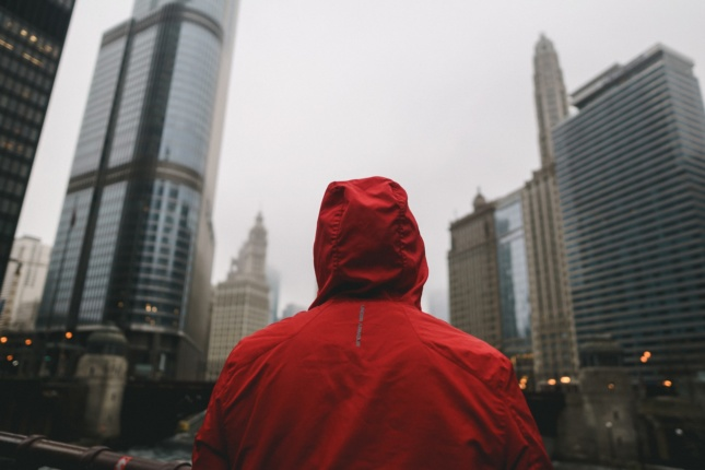 Photo of a person in a hood in downtown Chicago
