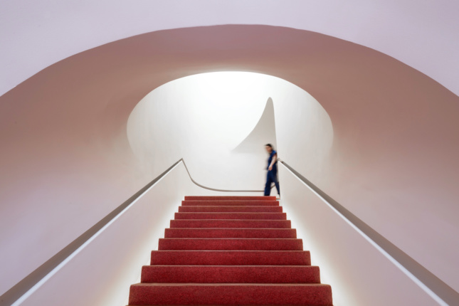 Interior photo of a white staircase in a makeup store