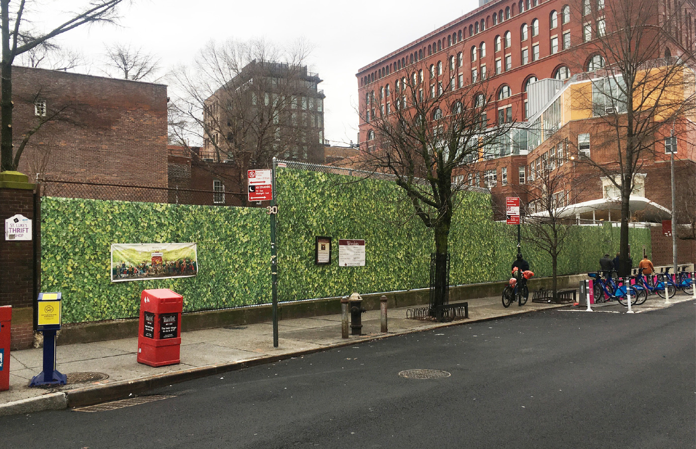 A school playground wrapped in fencing with fake ivy in Greenwich Village