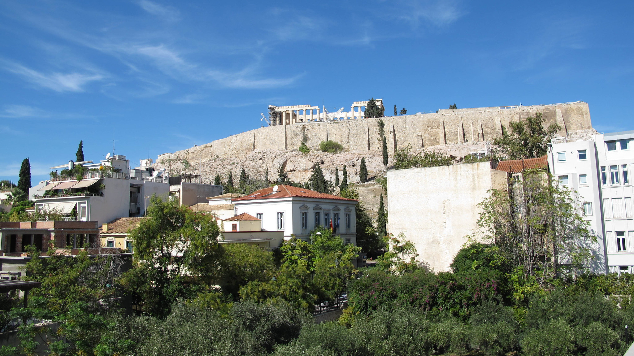 a view of the Acropolis in Athens on a sunny day