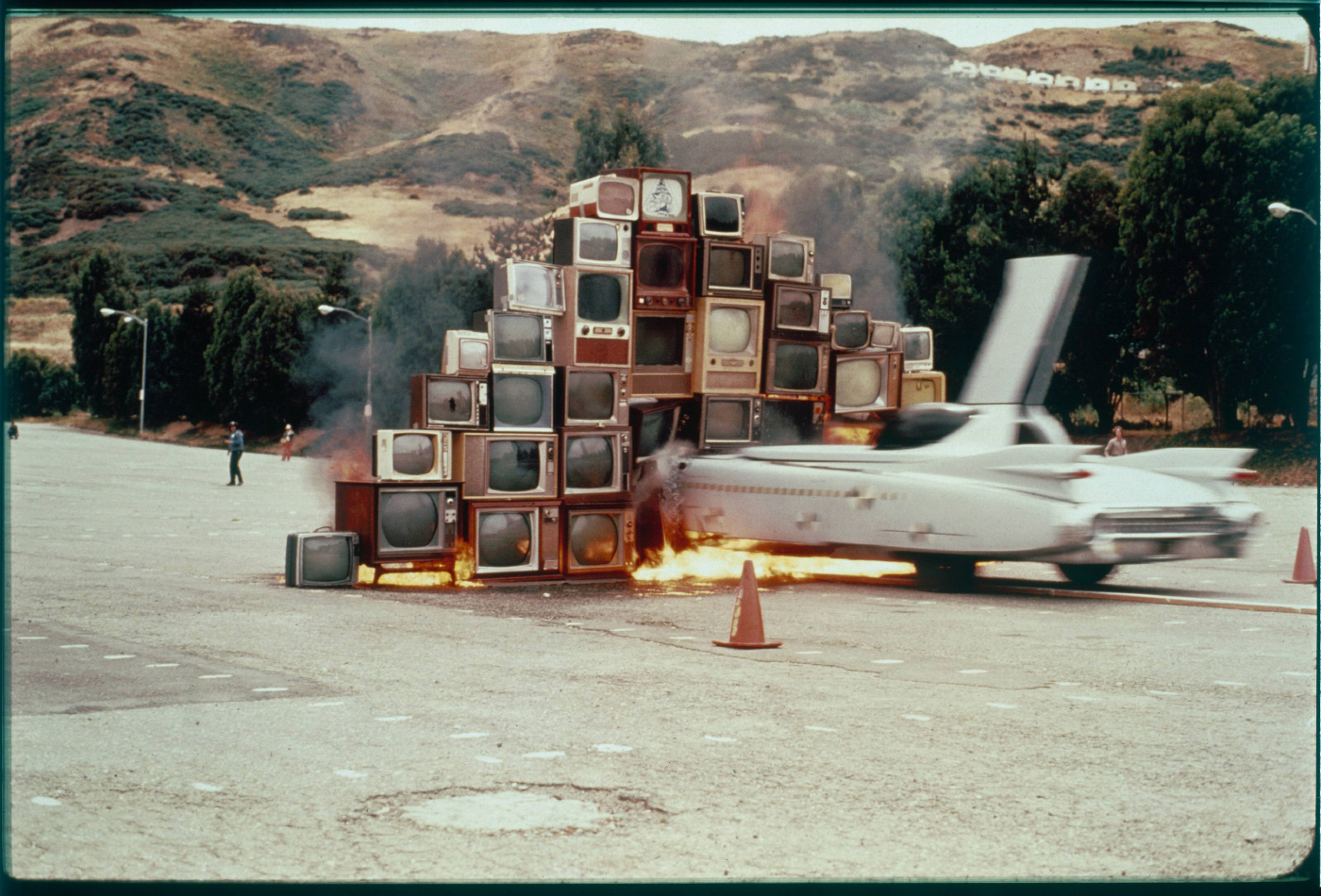 A car driving into a wall of television sets, from Ant Farm, on display at ADFF