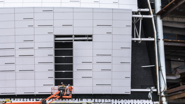 Image of panel installation with view of secondary support system