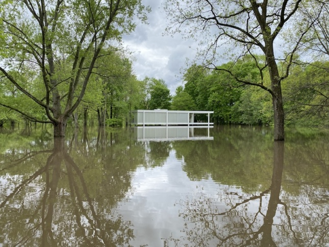 the farnsworth house in illinois surrounded by floodwaters