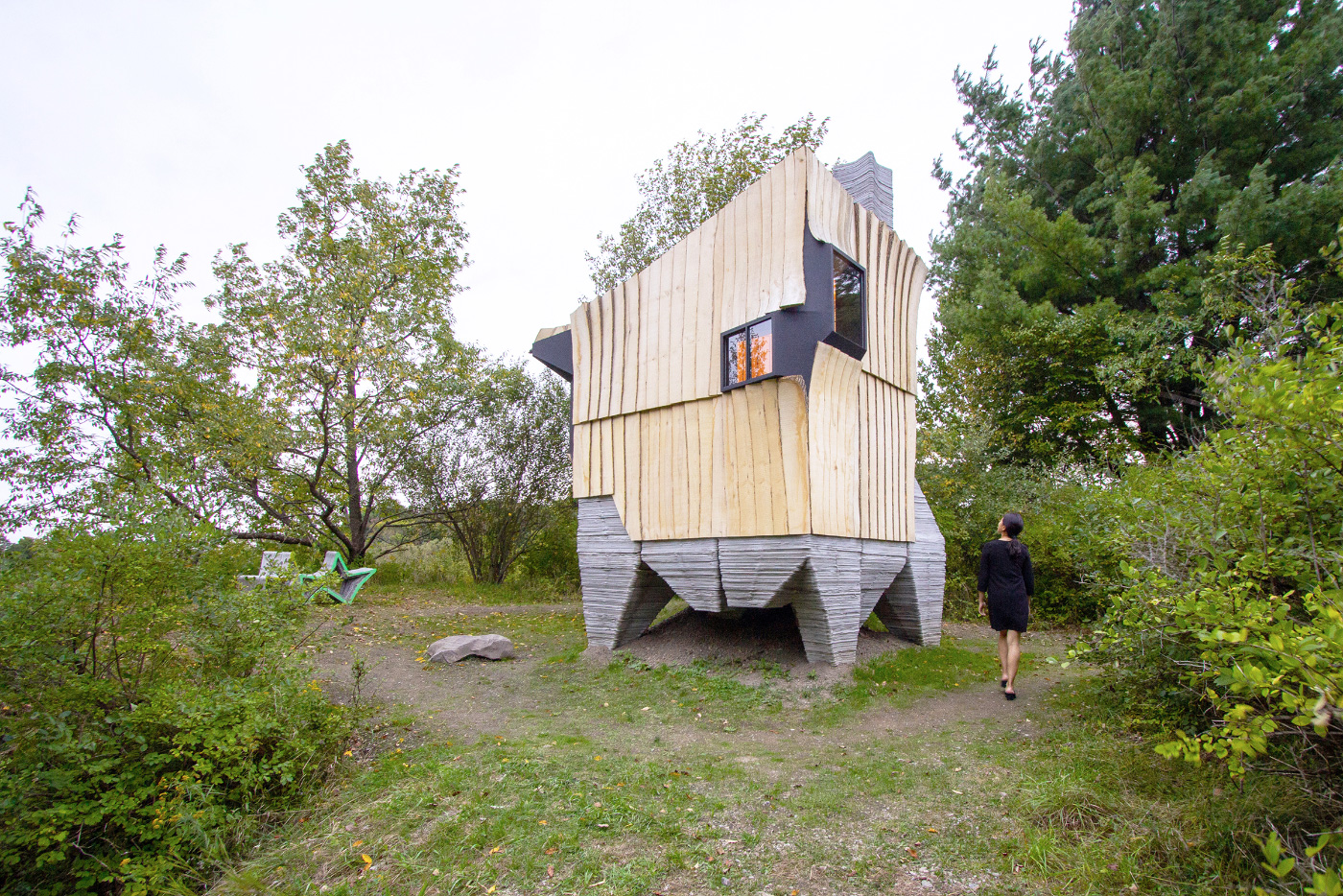 Looking at Ashen Cabin, concrete on the bottom and slivered wood facade up top