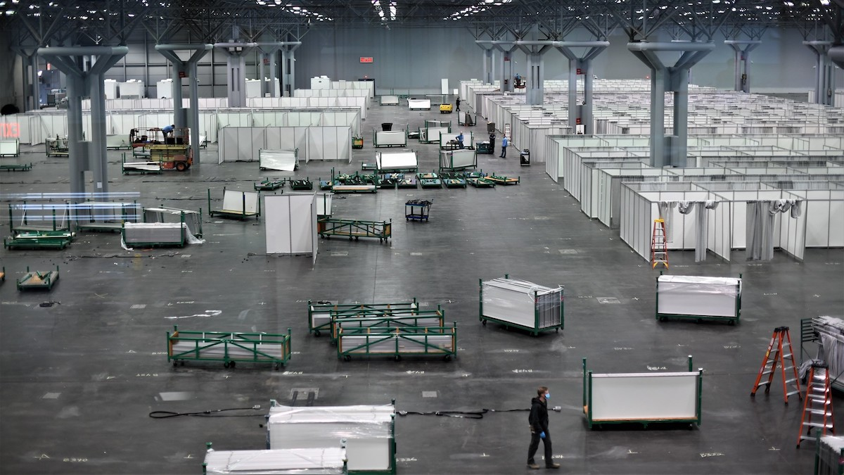the national guard assembles a field hospital in a convention center, one of many temporary coronavirus hospitals