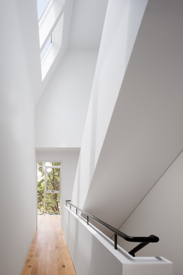 Inside a double-height white atrium