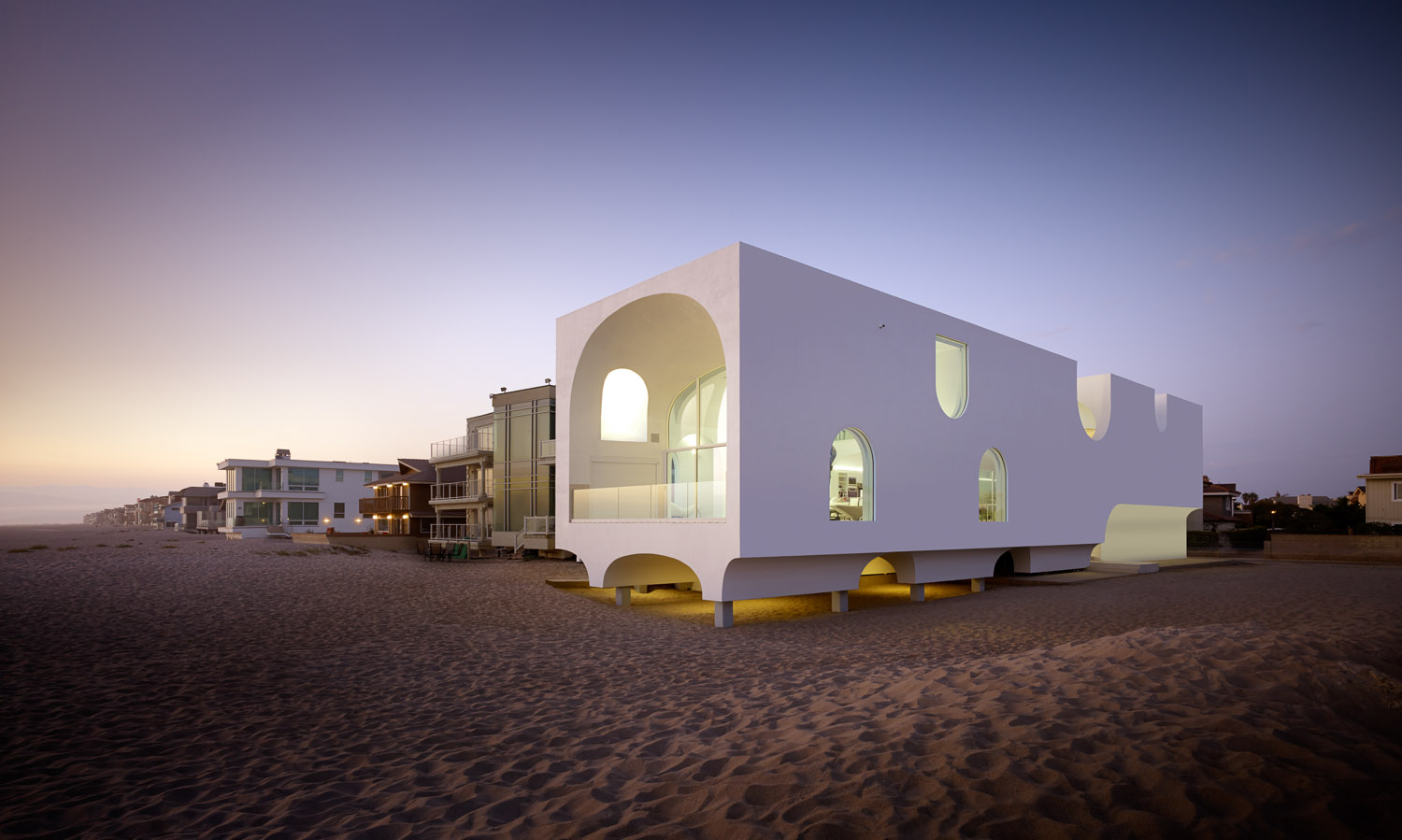 A Johnston Marklee-designed beach house with vault-shaped cutouts