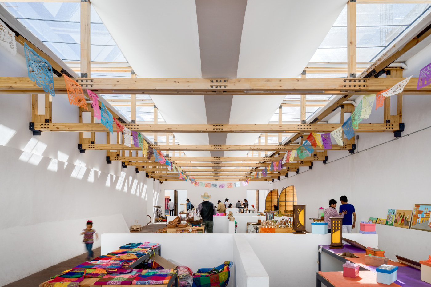 An open-air market hall designed by Architectural League Prize winner Vrtical