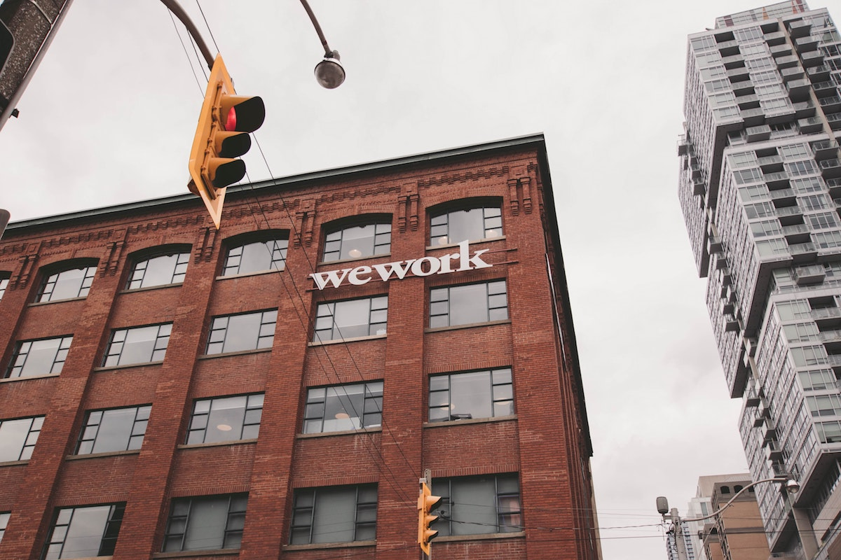 a brick building with a wework sign